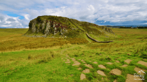 What to pack for a day hike in the UK. Photo Hadrian's Wall in Northumberland National Park. The UK has so many different weather conditions that you might wonder what you should wear and take on your day hikes? Here's the ultimate list of everything I pack in my rucksack for my day hikes and walks in the UK coutnryyside and National Parks. Be sure to check it out so you don't forget anything important. Hiking tips