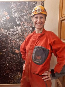 Becky the Traveller in red overalls and helmet ready to go caving in Budapest