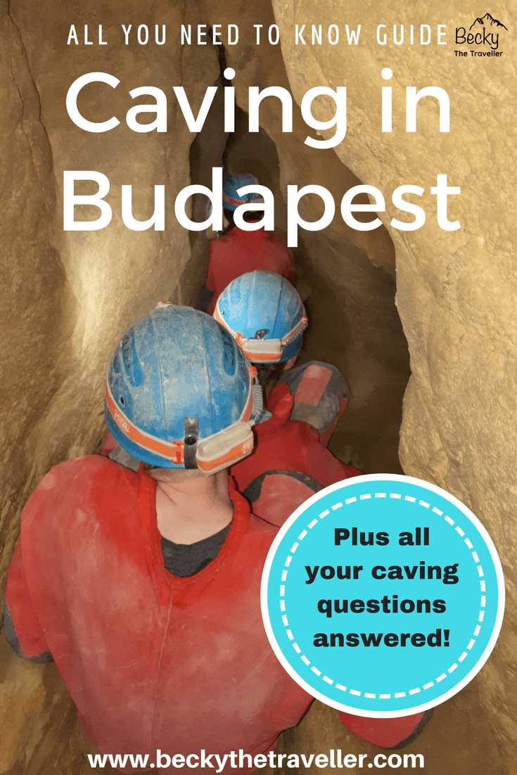 Caving in Budapest - our group going through a tight section of the cave