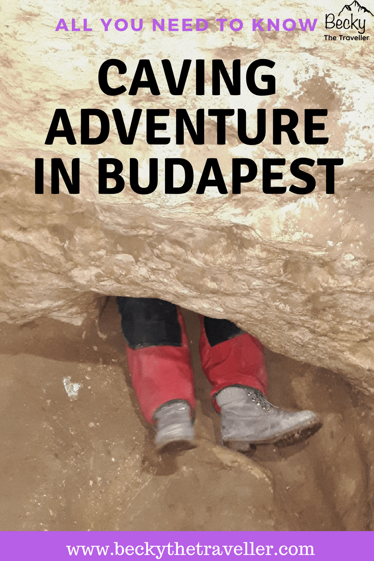 Caving in Budapest - legs going through a tight section of the cave