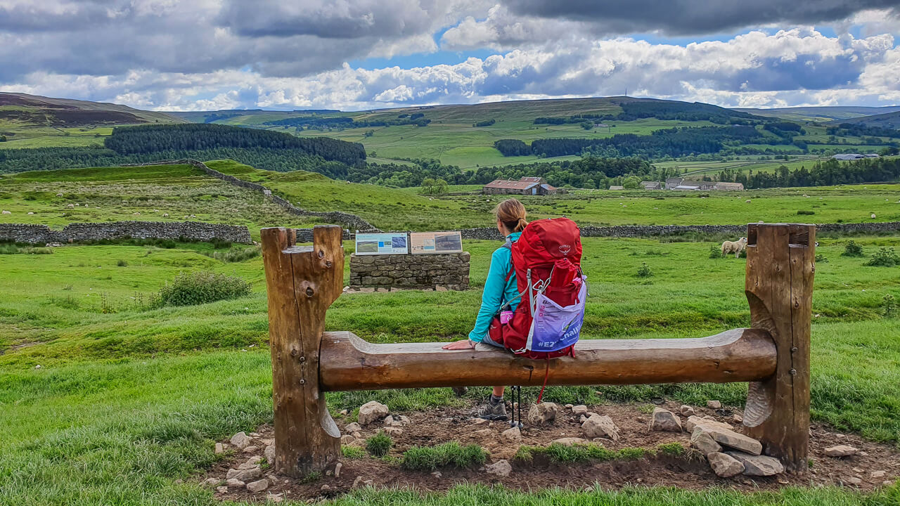 Sat on bench with backpack on Pennine Way