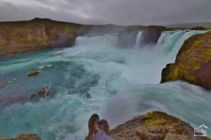 Iceland waterfall and boots