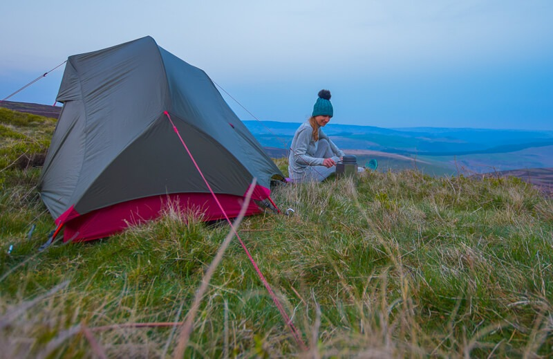 tent camping trip with person in thermals