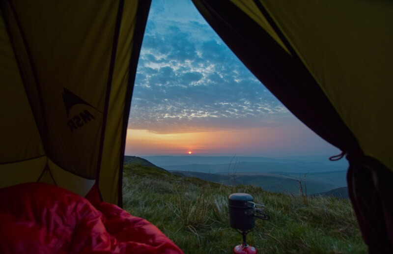 views from tent whilst camping with gas stove