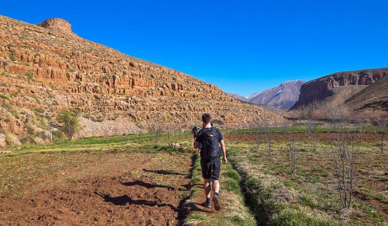 Walking through valley in Atlas Mountains