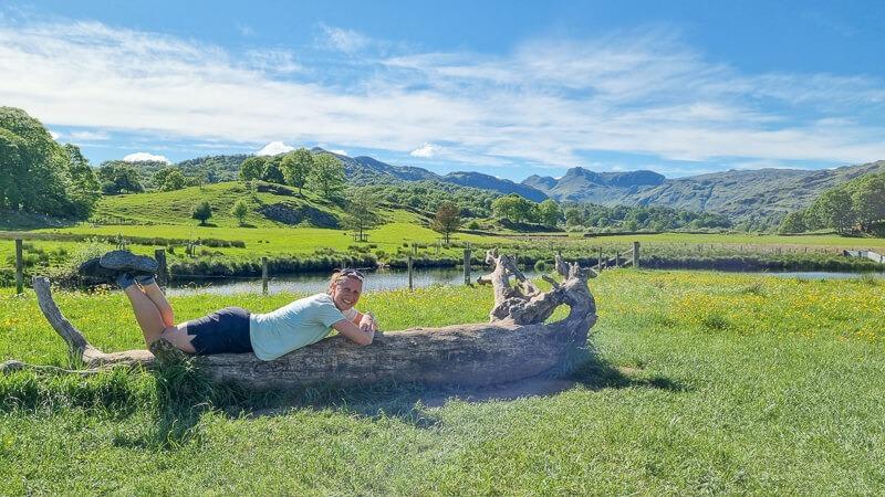 Becky lying on log on Cumbria Way