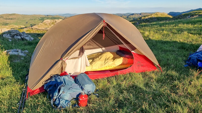 MSR Hubba tent open with sleeping bag inside
