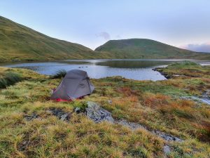 Tent next to tarn