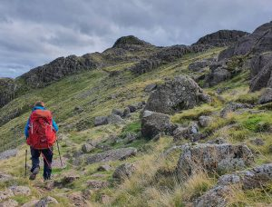 Person hiking with red backpack