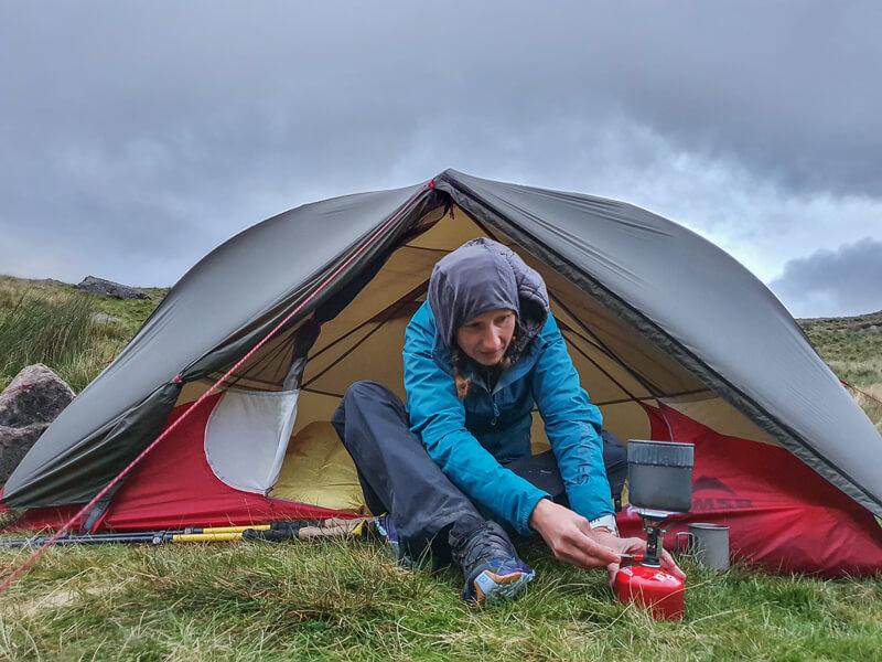 Sat next to tent lighting stove
