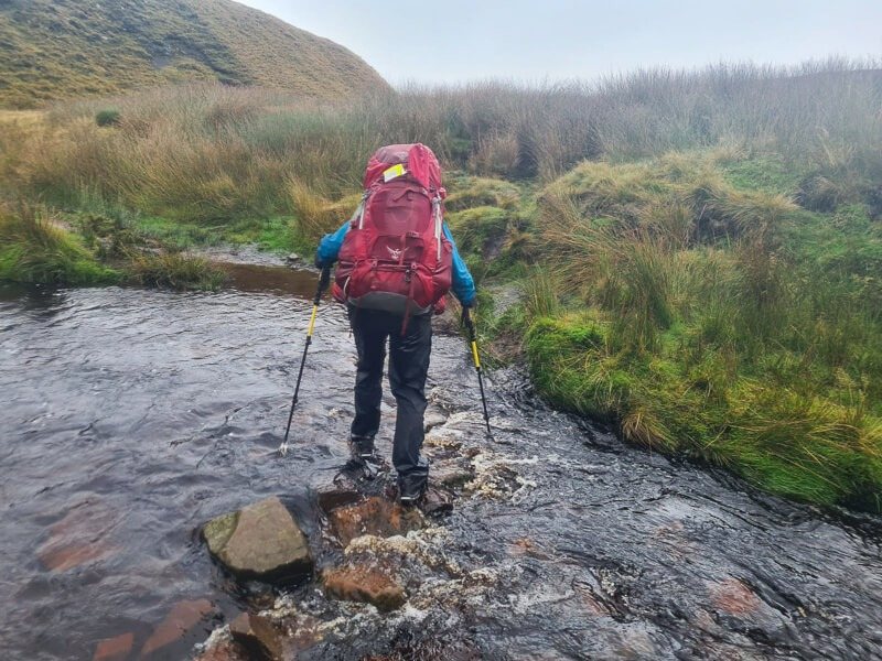 Becky crossing water over stones