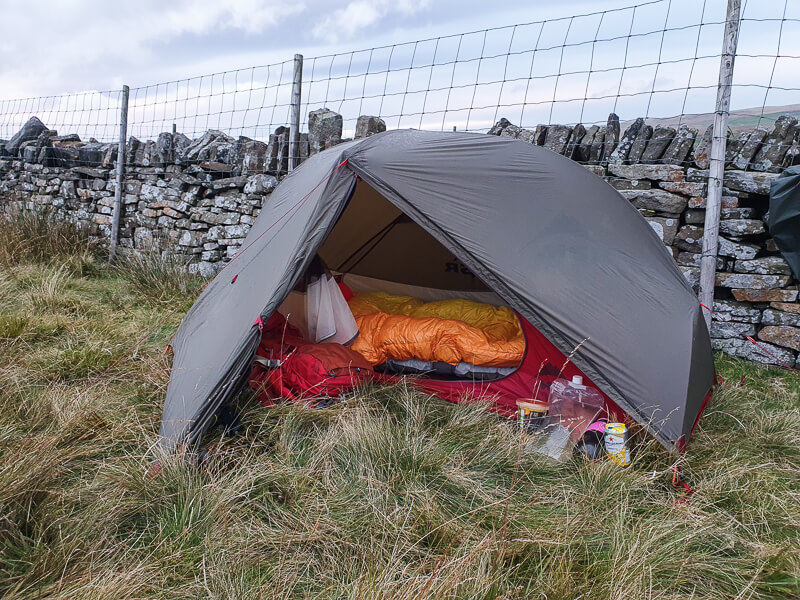 MSR tent pitched against a wall