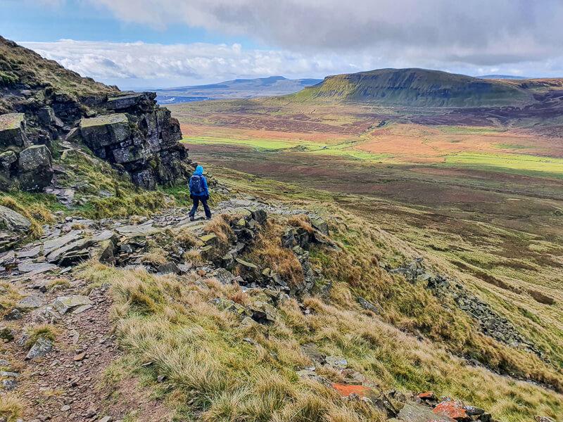 Walking down rocky path