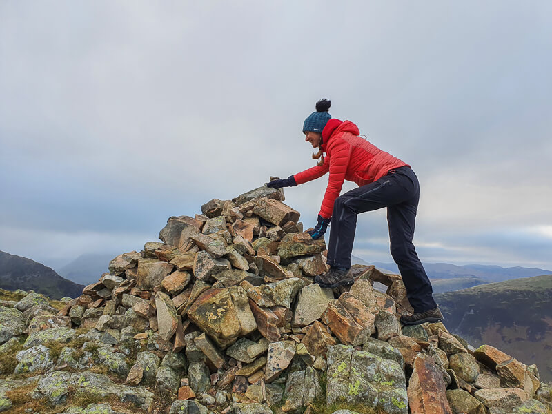Climbing up stone cairn