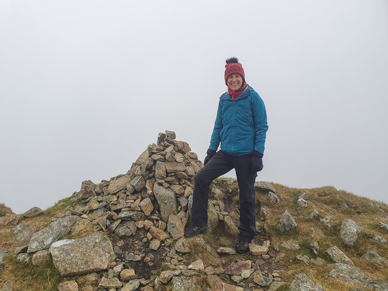 Stood next a stone cairn