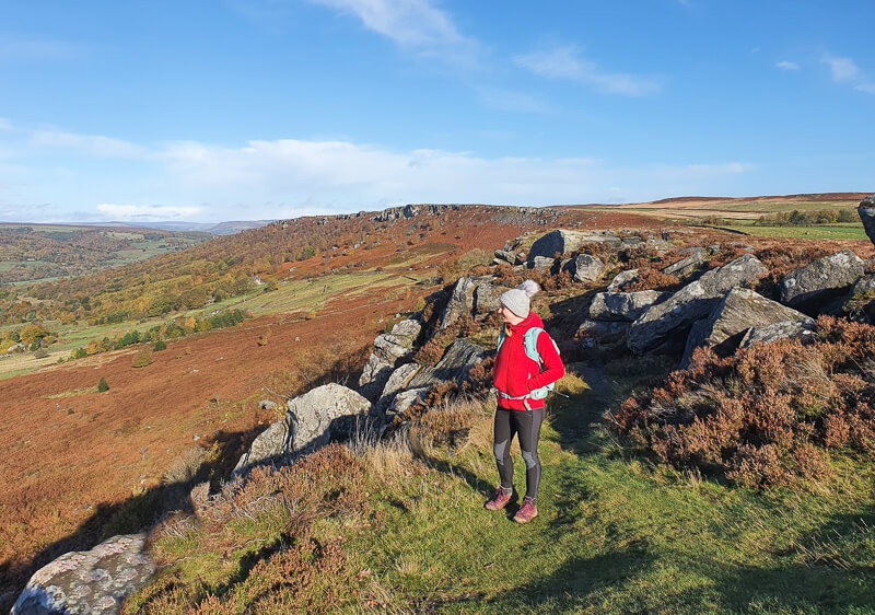 Baslow Edge - Becky stood with handy in pockets