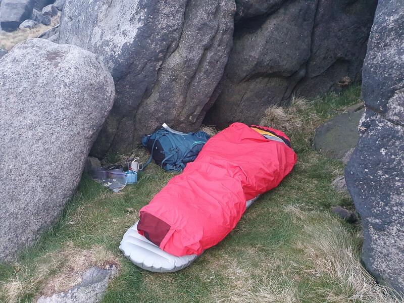 Bivvy bag in between rocks