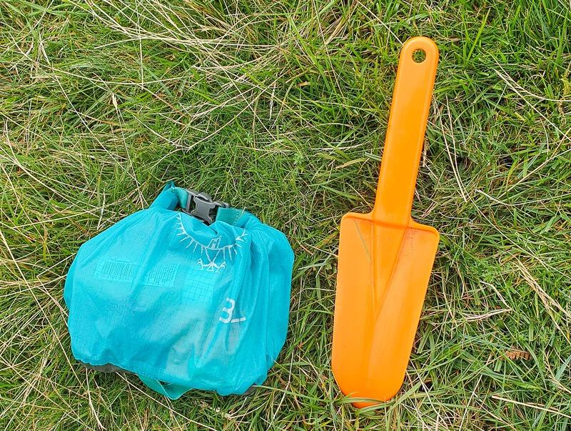 Trowel and blue bag