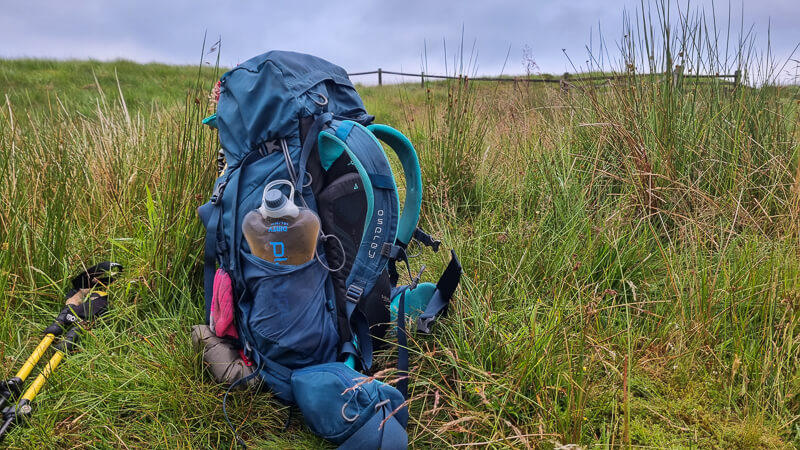 Backpack with water filter in pocket