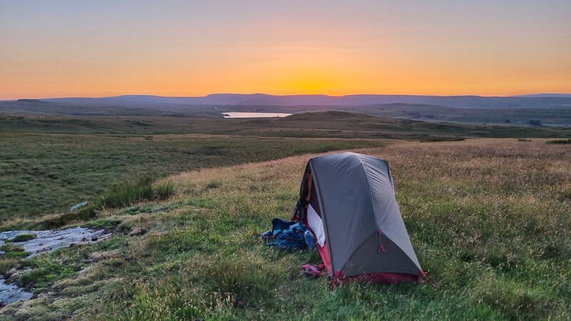 MSR Hubba tent on grass with sunset colours
